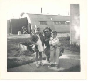 Eva Wenzel with daughter, Susan, and newphew, Tim Kerry, in front of her hut.
