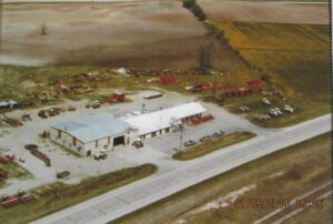 1980 aerial view of VAn Zeeland IMpleent Company on Hwy 00 or Hyland Avenue.